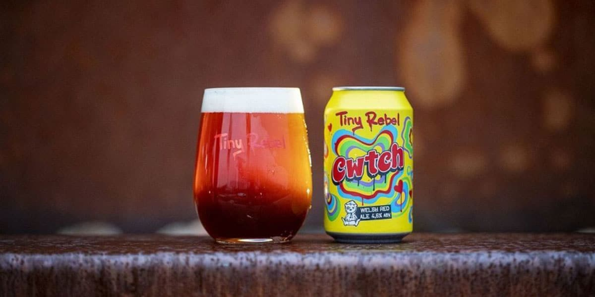 A can of Tiny Rebel Cwtch beside a glass poured